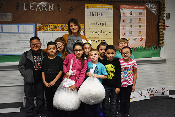 Mrs. Hall and her class show off their work in collecting water bottle caps for the chemotherapy project.  Morton Elementary students raised over 26,000 caps during the contest.