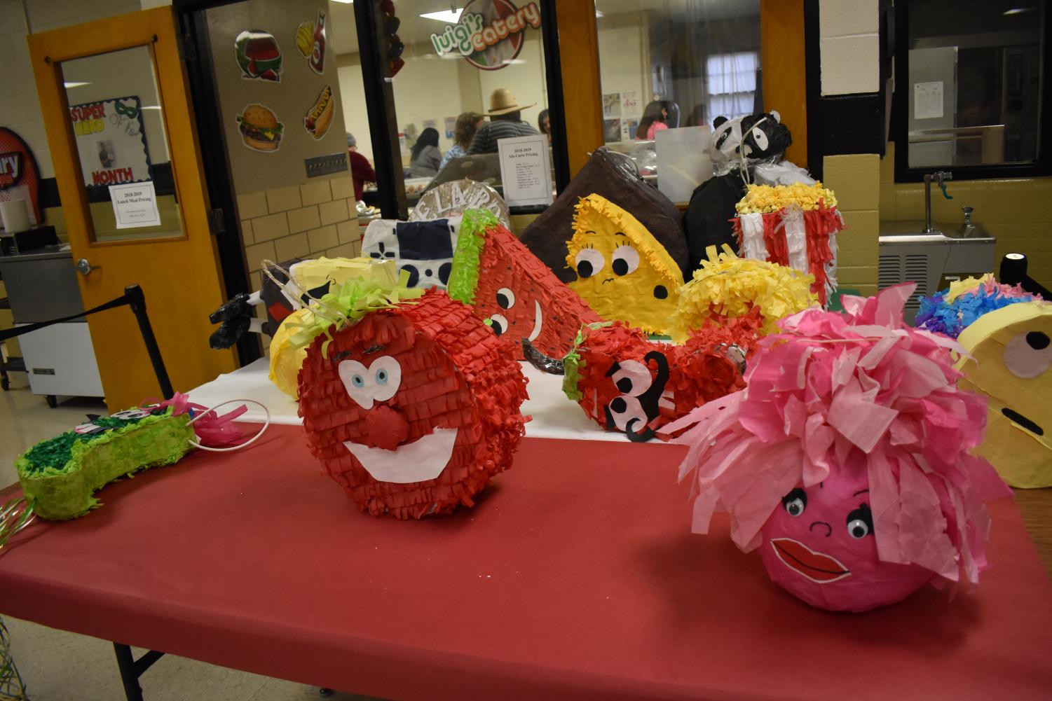 Pinatas created by High School students are ready for the lottery at the Cinco de Mayo Festival on May 6 at the Elementary school