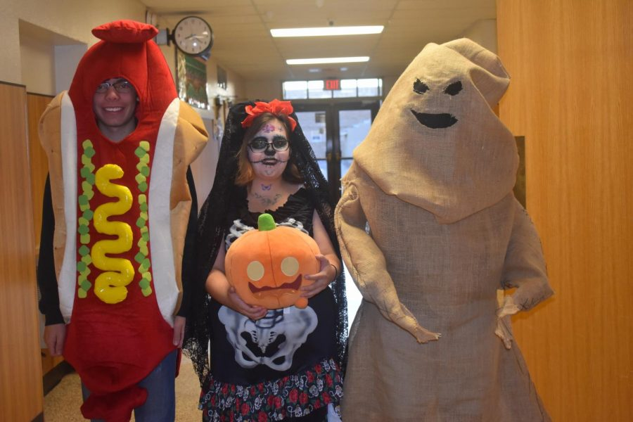 Juniors Jackson Greener, Cheyenne Barnes and Xander Benavidez show off their Halloween costumes for Red Ribbon Week.