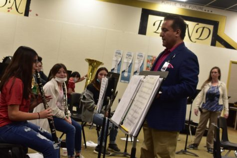 Pano Mata directs 7th-grade band students on breathing technique in a clinic held in Morton on February 23.