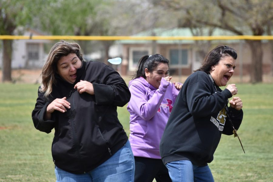 Mrs. Ramos, Mrs. Brito and Mrs. Geener react to being hit with water balloon thrown at them by the third graders on Friday.