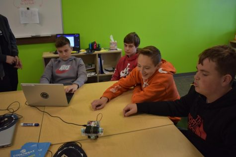 Junior High students Jaeden Alvarado, Jacob Unger, Micah Zapata and Britton Boggs test their robotic vehicle while at Coding Ninjas on April 22