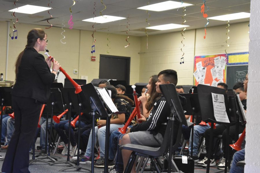 Elementary band students perform with recorders and plastic trumpets at Cinco de Mayo night on May 4 in the Elementary Gym