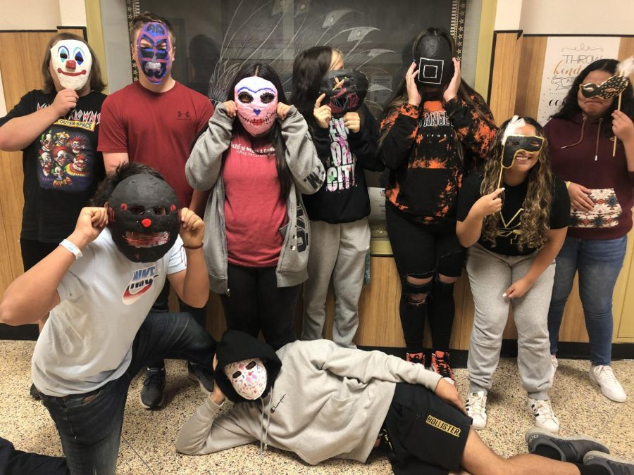 Art students display Paper Mache masks they created this week in class.